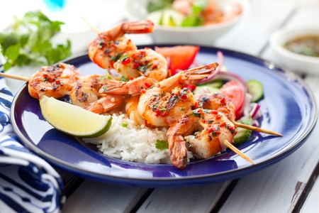 prepared shrimp: Prawn skewers with rice and vegetable salad Stock Photo