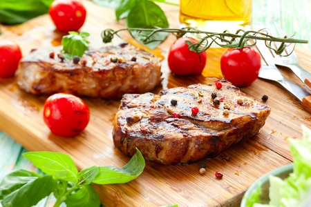 Grilled veal loin steak on cutting board