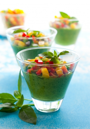 Green Gazpacho soup in glasses photo