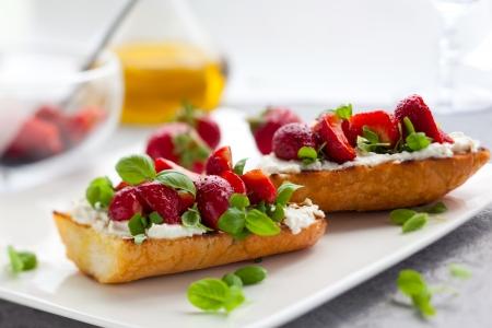 goat cheese: Strawberry bruschetta with goat cheese,basil and balsamic vinegar Stock Photo