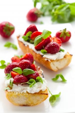 balsamic: Strawberry bruschetta with goat cheese,basil and balsamic vinegar Stock Photo