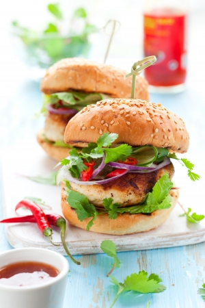 chicken burger: Thai chicken burger with cucumber and sweet chilli sauce Stock Photo