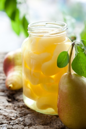 Canned pear compote in jar Stock Photo