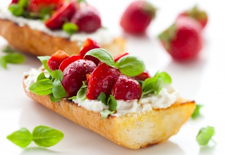 balsamic: Strawberry bruschetta with goat cheese,basil and balsamic vinegar Stock Photo