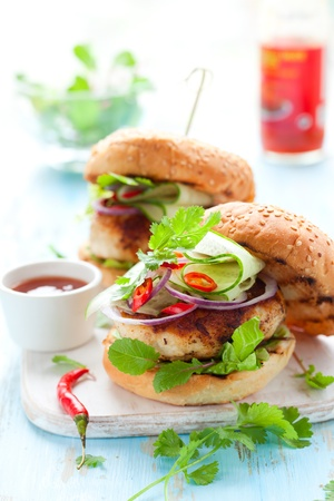 green chilli: Thai chicken burger with cucumber and sweet chilli sauce Stock Photo