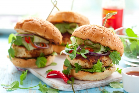 Thai chicken burger with cucumber and sweet chilli sauce Stock Photo