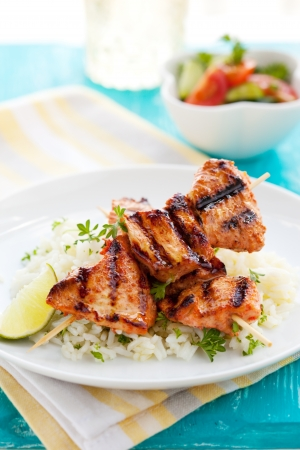 marinate: Delicious chicken masala skewers with rice and vegetable salad