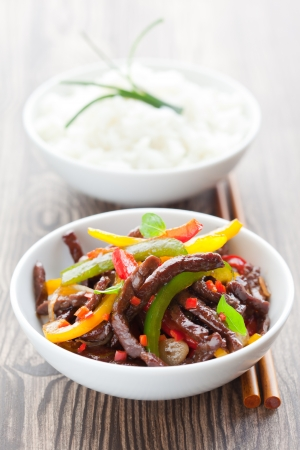 beef stir-fry with vegetable and rice photo