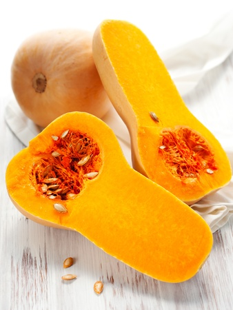Butternut squash, whole and halved Stock Photo