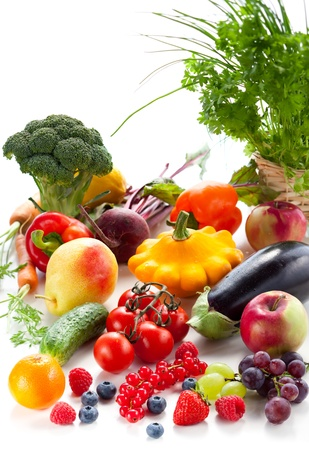 Fresh vegetables,fruits and berries on the white background photo