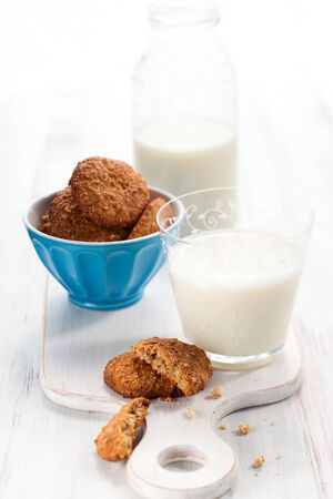Oatmeal  cookies and a glass of milk photo