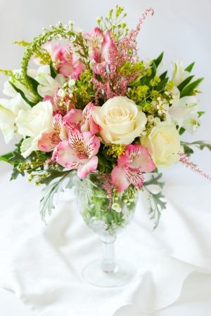 roses in vase: A festive  bouquet in a vase on the table Stock Photo