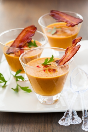 pumpkin soup with bacon in glasses photo