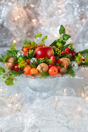 Christmas table decoration with fruit, nuts, fir branches Stock Photo - 15572554