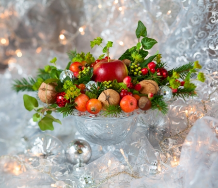 Christmas table decoration with fruit, nuts, fir branches photo