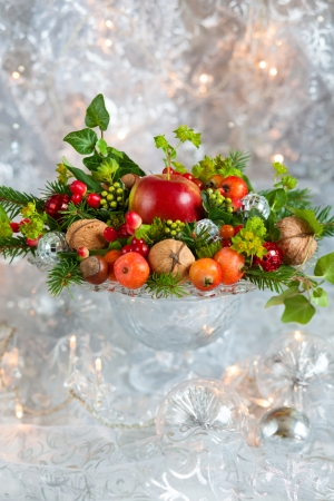christmas meal: Christmas table decoration with fruit, nuts, fir branches