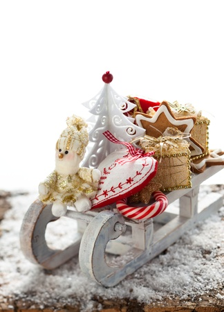 Christmas sleigh with gifts,sweets and cookies Stock Photo - 15733108