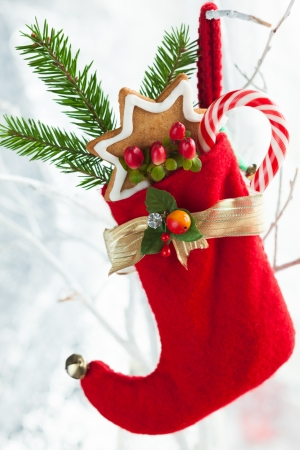 Christmas stocking with gifts,sweets and cookies photo