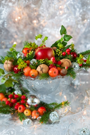 Christmas table decoration with fruit, nuts, fir branches Stock Photo - 15801259