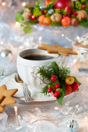 Coffee and Christmas cookies with decor photo