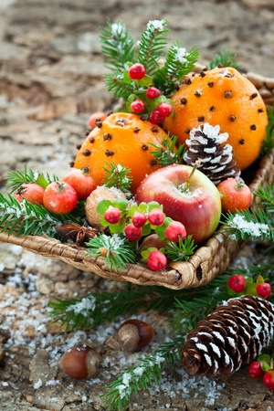 Christmas basket with fruits, berries and nuts photo