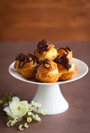 profiterole: Profiteroles with cream and chocolate sauce