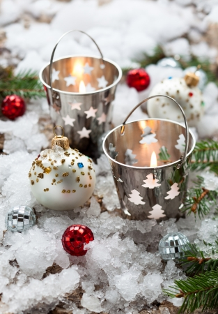 silver backgrounds: Christmas Decorations with candles in small pails Stock Photo