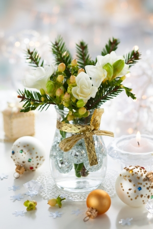 Christmas table decoration with flowers,gifts and baubles Stock Photo - 15801251