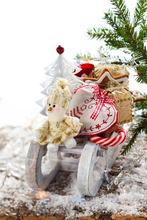 Christmas sleigh with gifts,sweets and cookies Stock Photo - 15884633