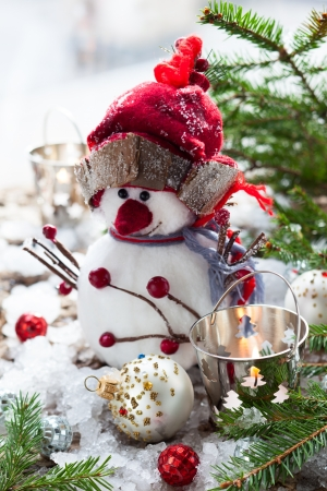 Christmas Decorations with snowman,candles and christmas baubles photo