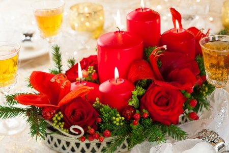 Christmas table decoration with flowers and candles photo