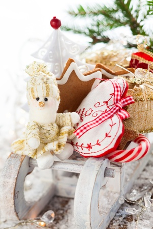 Christmas sleigh with gifts,sweets and cookies  Stock Photo - 16113297