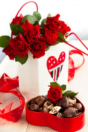 red roses  and chocolate candies for Valentine photo