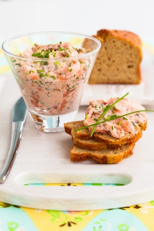 Salmon and soft cheese spread on bread photo