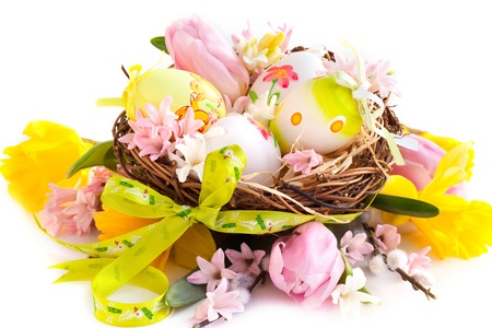 Easter Eggs in a nest with flowers photo