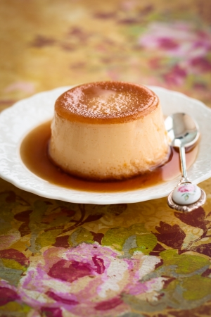 blancmange: Creme caramel on plate with spoon