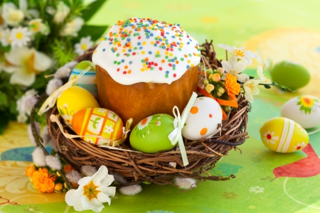 Easter cake and colourful eggs photo