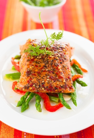 Salmon fillet with asparagus and red bell pepper photo
