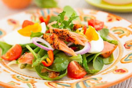 salmon salad with egg and vegetables photo