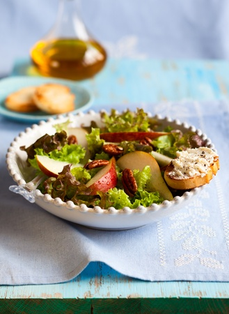 pear salad with walnut and soft cheese photo