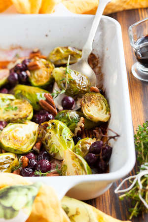 roasted brussels sprouts with grapes,nuts and balsamic vinegar photo