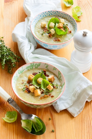 Cream of brussel sprout soup with potato and bacon  photo