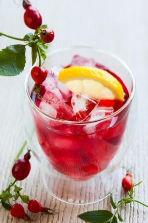 iced tea: glass of cold rose hip tea Stock Photo