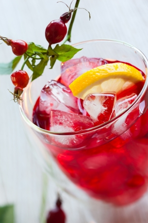 glass of cold rose hip tea photo