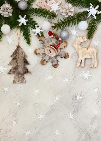 christmas decorations with white background: Christmas decoration on the grey cracked stone background