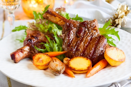christmas dish: Veal chop with vegetables for Christmas dinner Stock Photo