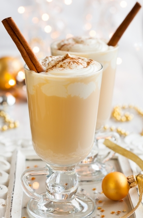 punch spice: Egg Nog with Cinnamon Sticks Stock Photo