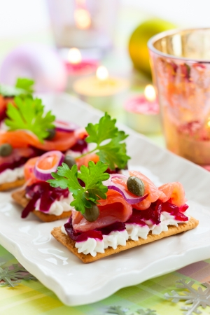 Holiday appetizer with salmon and beetroot Фото со стока