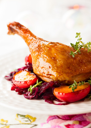 duck: Roasted duck leg with red cabbage and apples for Christmas