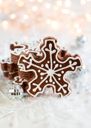 Gingerbread Snowflake Cookies with decoration photo